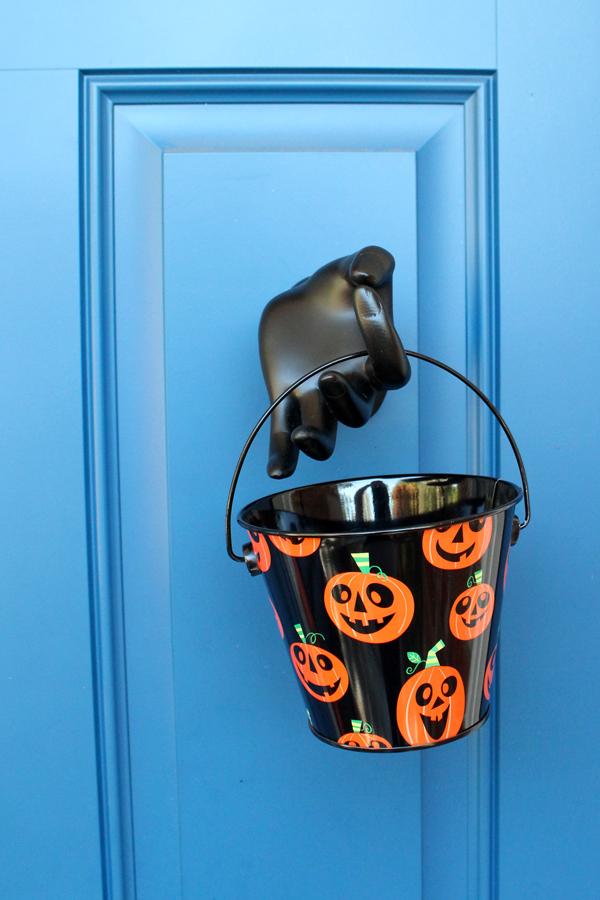 Mannequin hand with a Halloween bucket