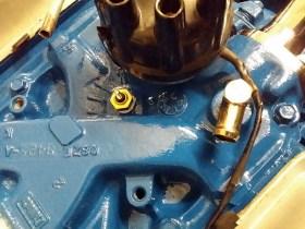 water sender left below distributor cap