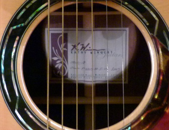 Kathy Wingert Model F Custom - sound hole label - guitar review at onemanz.com
