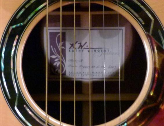 Kathy Wingert Model F Custom - sound hole label - guitar review at onemanz.com