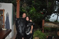 Happy guests with make-shift raincoats