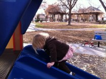 Climbing up the slide is her latest favorite thing to do