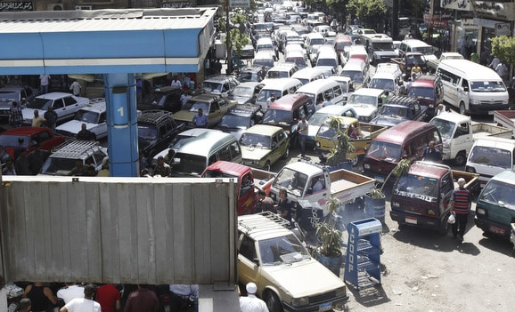 Vehicles queue at a petrol station at a gas and a petrol station during a fuel shortage at the country in Cairo. Gas holds value during a recession.