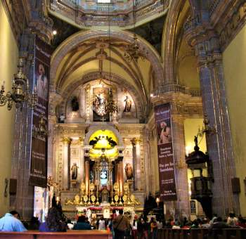 Interior of basilica showing the statue of Our Lady above the main altar.