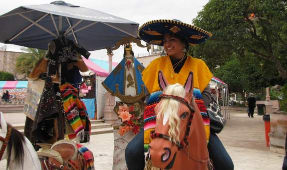 Photo opportunity for children (to sit on horse with the image of Our Lady of San Juan de los Lagos); familiar sight at basilica
