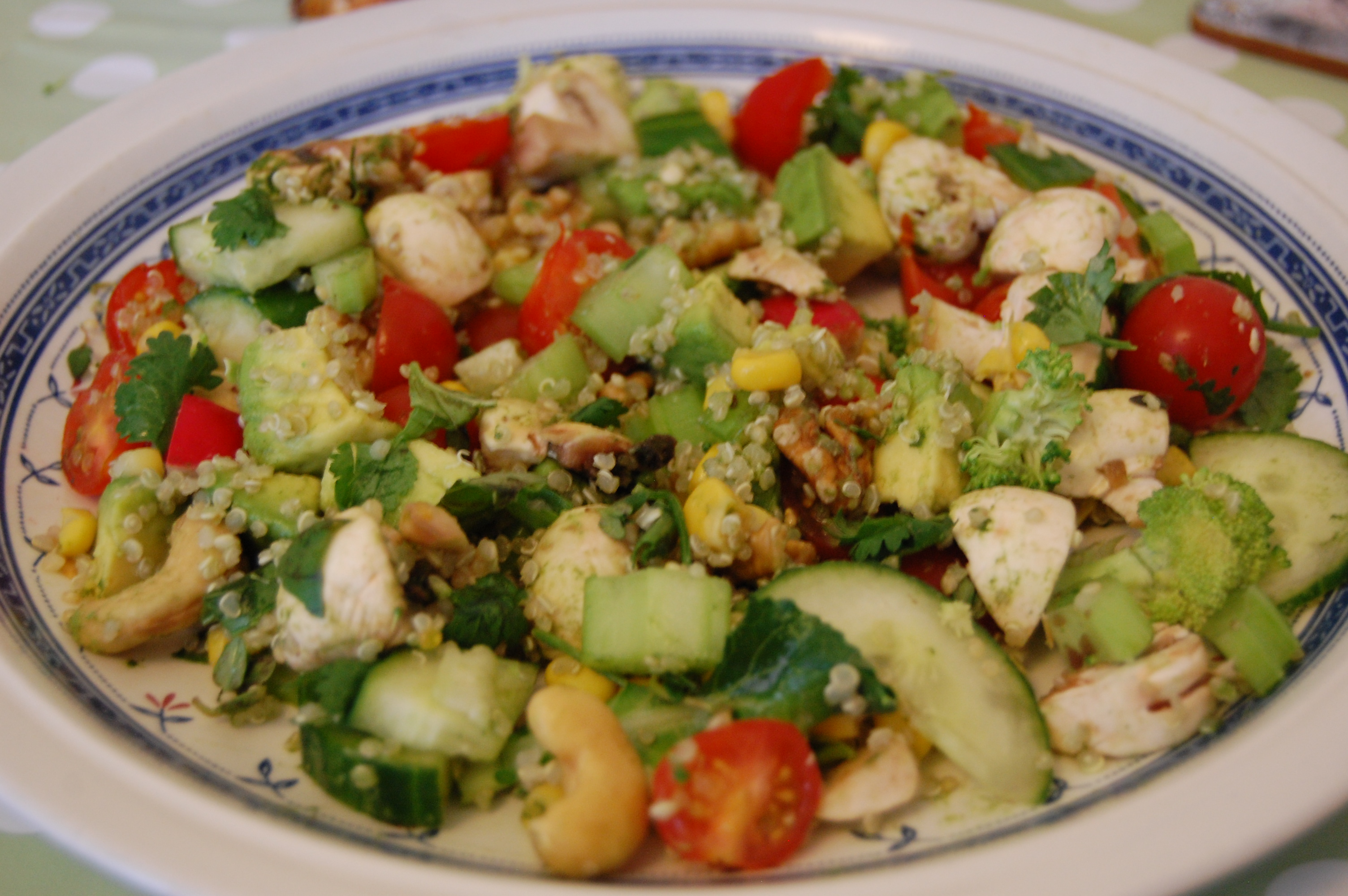 A colourful salad made with quinoa, nuts and herbs.
