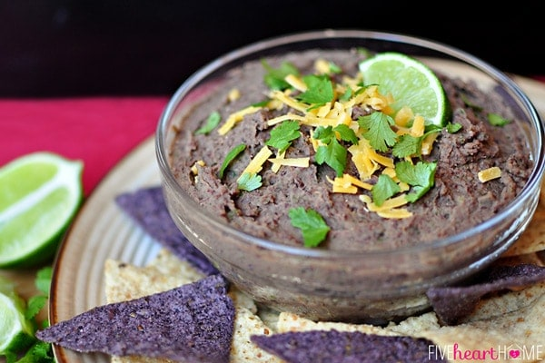 Today I'm borrowing from the first two categories to share a healthy yet flavorful dip that would be a perfect addition to your upcoming Super Bowl festivities! Nutritious, protein-packed black beans are the star of this dip, and if you'd like, you can ratchet up the wholesome factor even more by serving it with veggie dippers in addition to (or in lieu of) tortilla chips. Black beans can be rather bland on their own, however, so this smooth and creamy dip relies on a variety of flavor boosters. Garlic, jalapeño, and cilantro add freshness while cumin, garlic salt, balsamic vinegar, and lime juice add seasoning.  Zesty Black Bean Dip | Five Heart Home