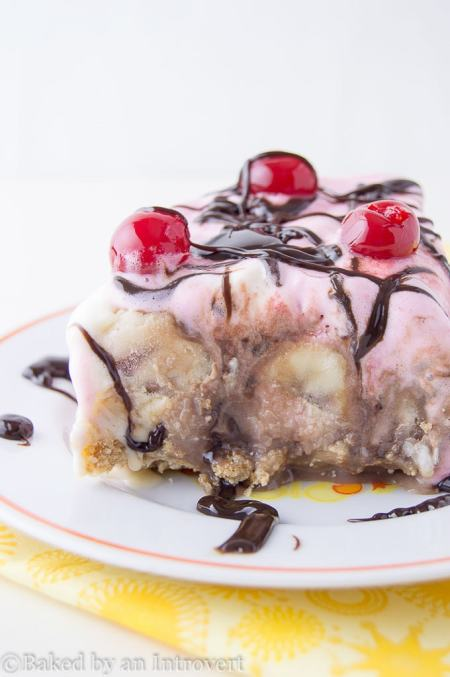 Banana Split Icebox Cake - An icebox cake layered with vanilla and strawberry ice cream on top of a buttery cookie crust; loaded with sliced bananas and hot fudge.