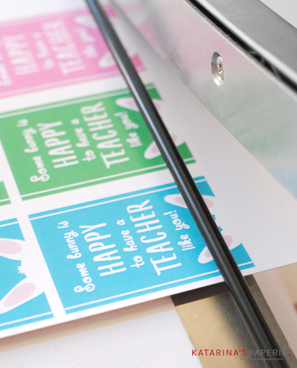 Cutting the free printable teacher Easter gift tags