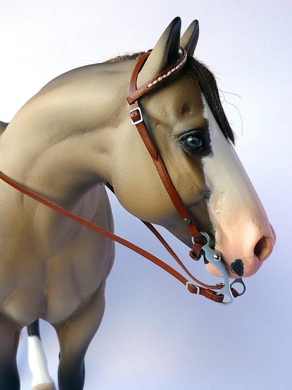 One ear bridle using 3D printed bit and stitched detail