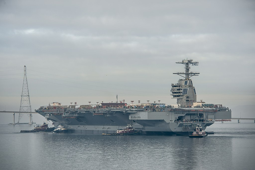 USS Gerald_R._Ford_moves_to_Newport_News_Pier_3_(131117-N-ZZ999-101).jpg