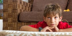 Bedwetting boy with watch