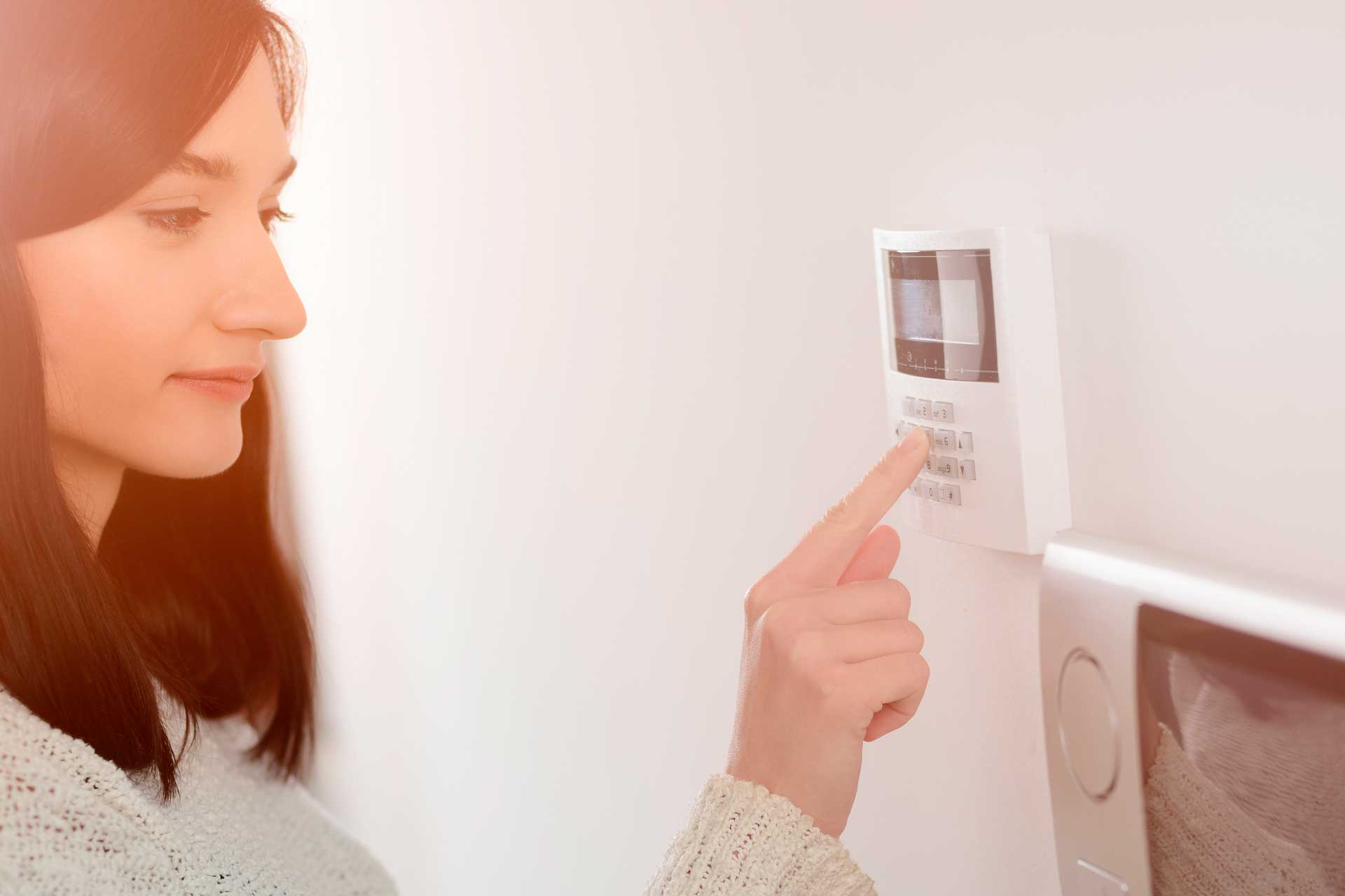 Woman using a keypad for a security system
