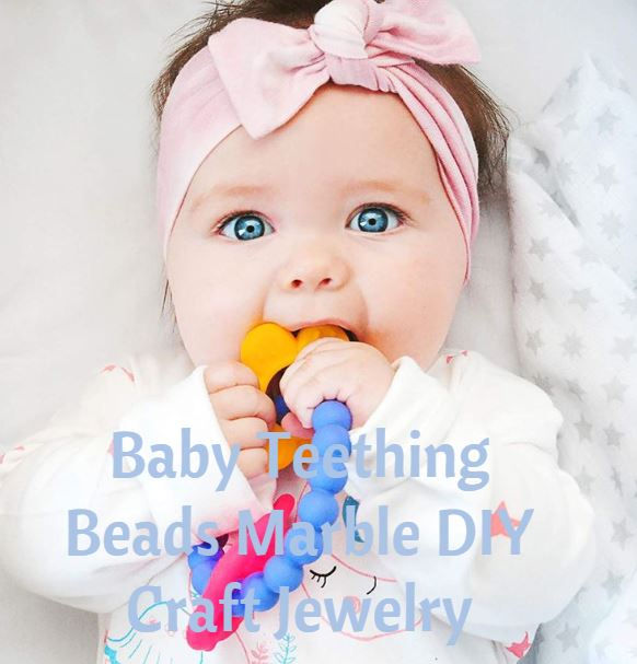 Baby chewing on teething necklace