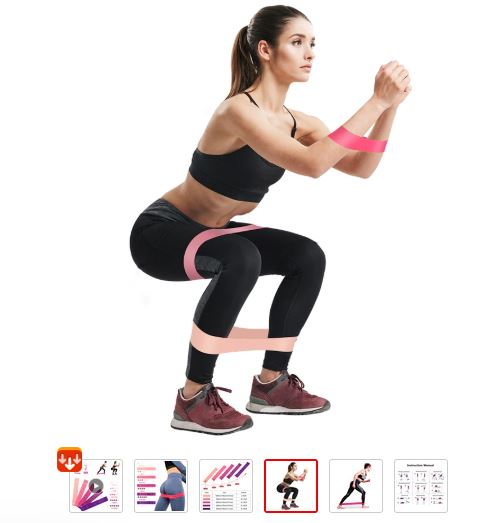 Lady doing squats with resistance band
