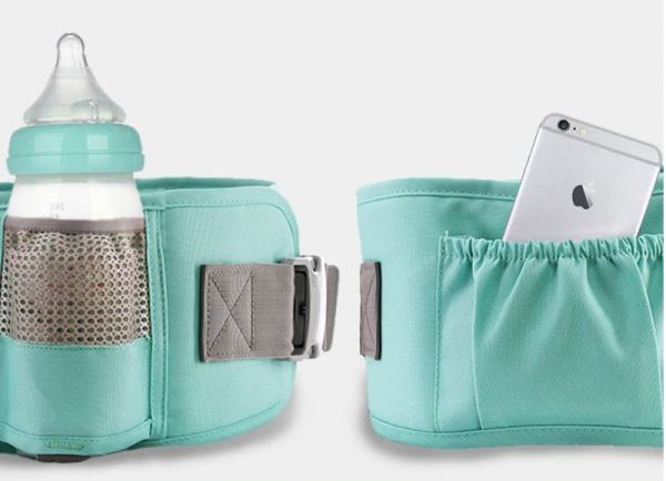 Storage pouch and bottle holder on baby carrier.