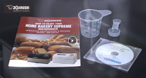 Recipe Book, DVD and Meauring Cup and Spoon