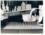 Komar being sandwiched between two bed of nails