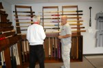 Charles Trudeau of Phoenix Bats shows a visitor a collection of bats used by major league players