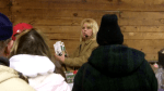 Leona Cliszka the second auctioneer selling items on the opposite side of barn