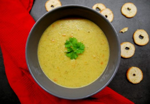 bowl of broccoli cheddar soup with bread chips