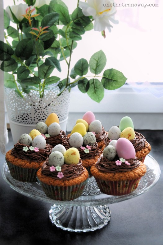 last minute easter nest cupcakes on a glass platter by the window