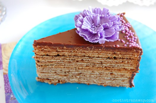 slice of authentic German Baumkuchen with fondant flower