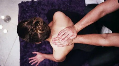 man-giving-a-back-massage-to-his-girlfriend