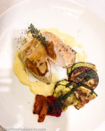 Apricot stuffed chicken served with grilled aubergine and peppers