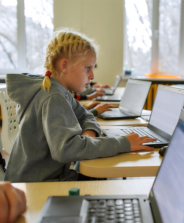 Girl on Laptop in Classroom