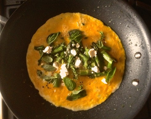 Asparagus and goat cheese omelet with thyme and basil