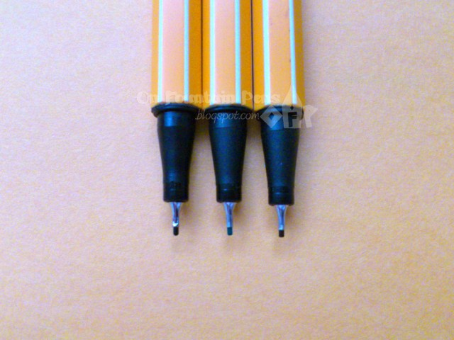 Left: the black point 88, still round.Centre: the green one, slightly less rounded.Right: brown with an almost square-cut nib