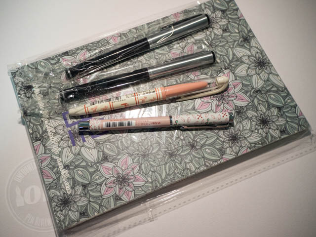 One notebook and four pens