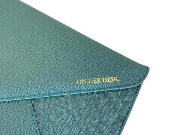 laptop case close up forest green of gold foil