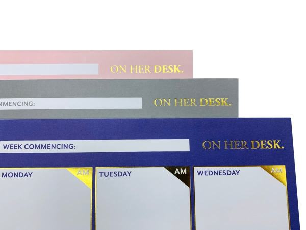 Weekly planners with gold foil detail close-up
