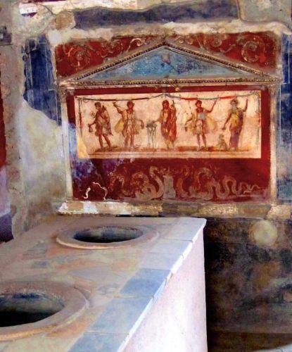 Fresque et jare de street food à Pompéi