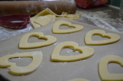 Heart-shaped shortbread ready to bake into the Queen of Heart's Tarts - jam-filled and dark chocolate covered.