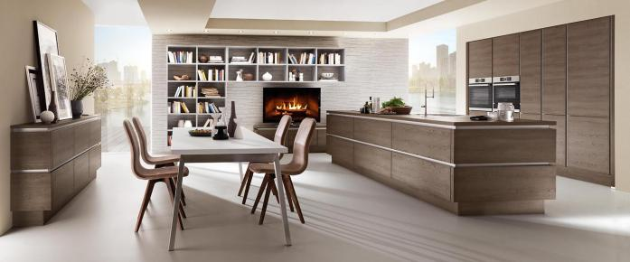 Homely deco and bookshelves make the kitchen and living space merge into a single unit.