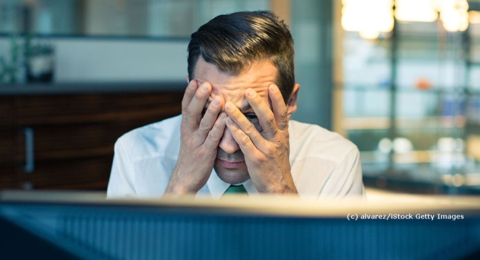 Prostate Aid Germany: Illustration picture work ability - stressed man in the office