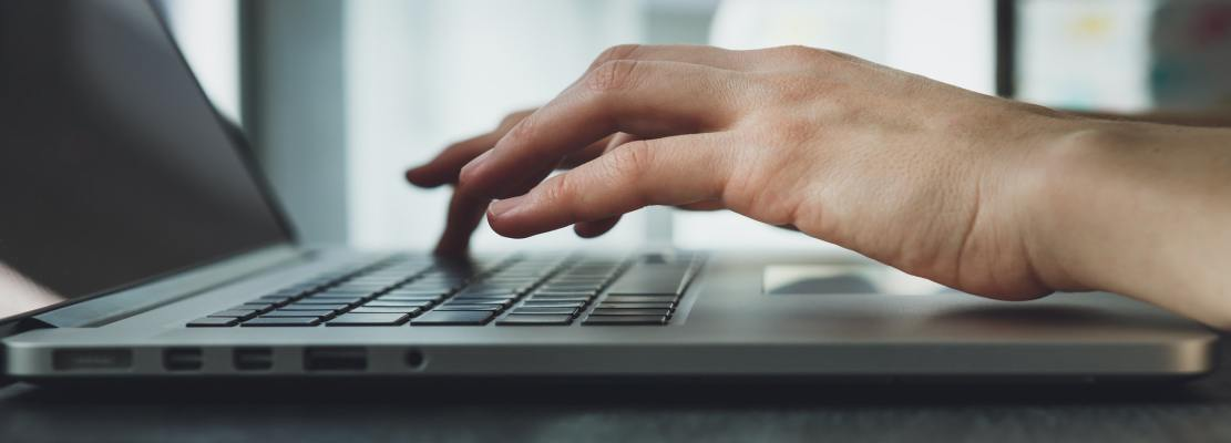 woman's hands working on laptop computer