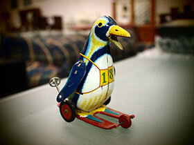 My-Old-Peguin-Tin-Toy-280x210