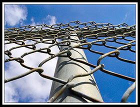 a chain fence used to describe link building by showing links of the chain