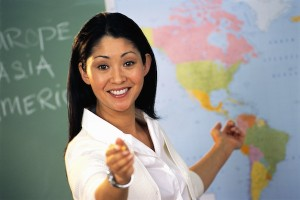 Teacher Pointing at Map of World