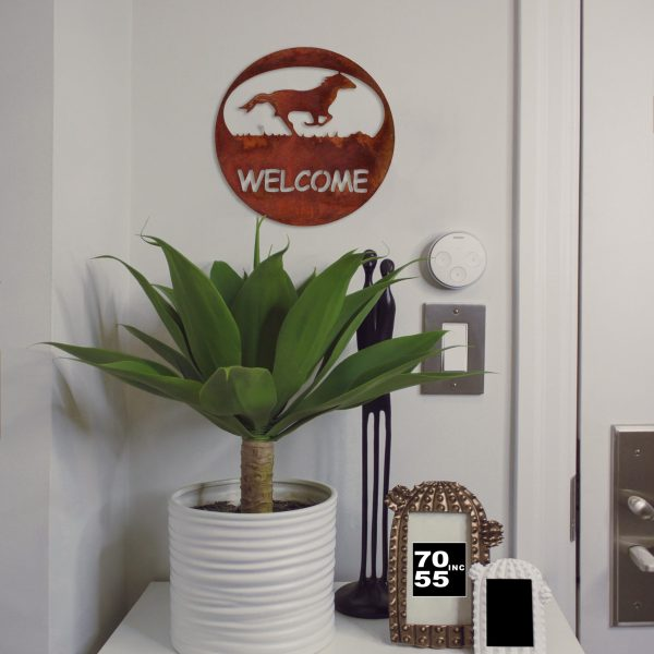 rust-horse-welcome-circle-by-door-scaled