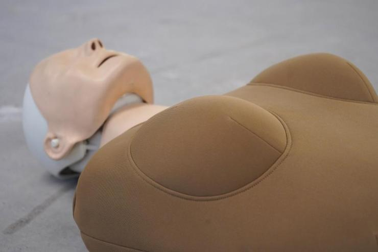 CPR practice dummy with added WoManikin sleeve.