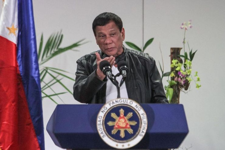 Philippine President Rodrigo Duterte speaks to the media after arriving in Davao on May 16, 2017, from a working visit to China.