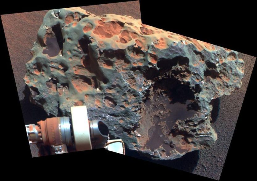 This iron-nickel meteorite, examined and photographed by Opportunity, represents the first such object ever found on the Martian surface. If you were to take this object and chop it up into its individual, constituent protons, neutrons, and electrons, you would find that the whole is actually less massive than the sum of its parts.