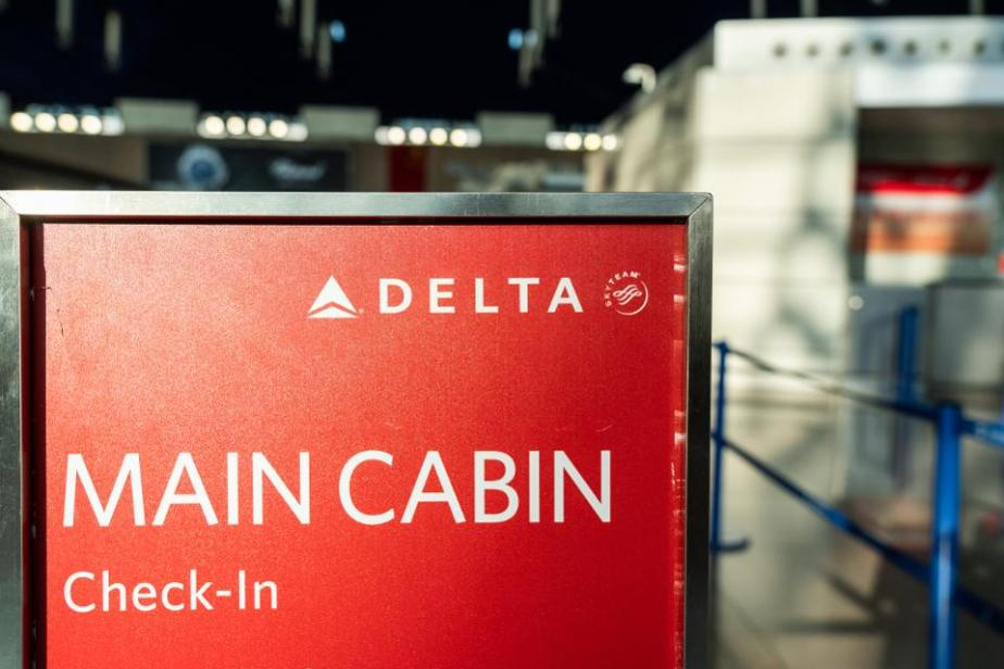 Delta Air Lines main cabin check-in sign seen in Shanghai...