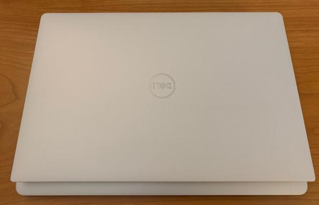 Dell XPS 13 on top and Retina MacBook Air on bottom. The XPS 13 is smaller and slightly lighter than the MacBook Air.