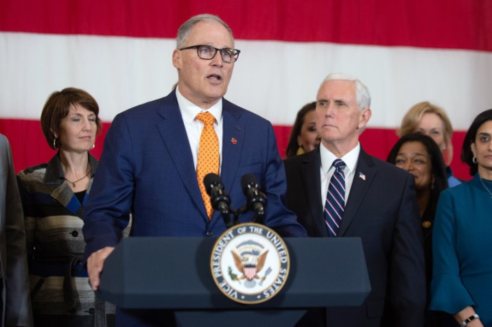 Gov. Jay Inslee of Washington address a news conference on the coronavirus in his state as Vice President Mike Pence looks on, in Tacoma on March 5, 2020.